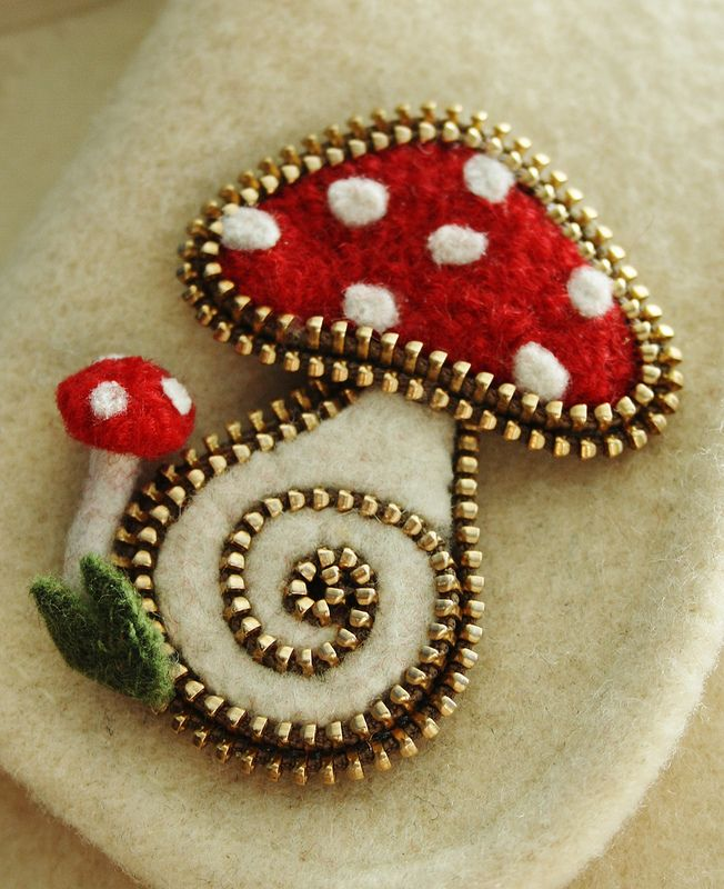 A little zipper and felt mushroom brooch