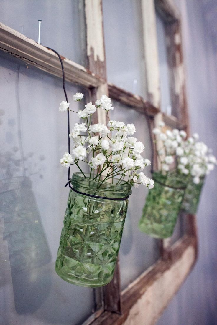 I have an old window frame like this - so would be solo cute to add jars with flowers