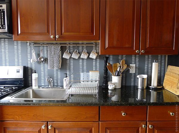 Magnetic knife holders aren't a new idea, but don't discount their sleek design as well as their storage sense. A repurposed curtain rod or towel bar can hold and display your graphic mugs and towels. Or, go all out and fill your backsplash with pegboard, for a crafty-chic look that doubles as super-flexible storage.