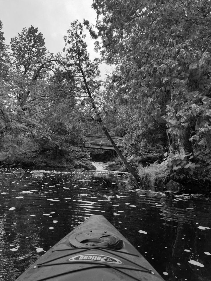Grayscale of my kayak and a waterfall