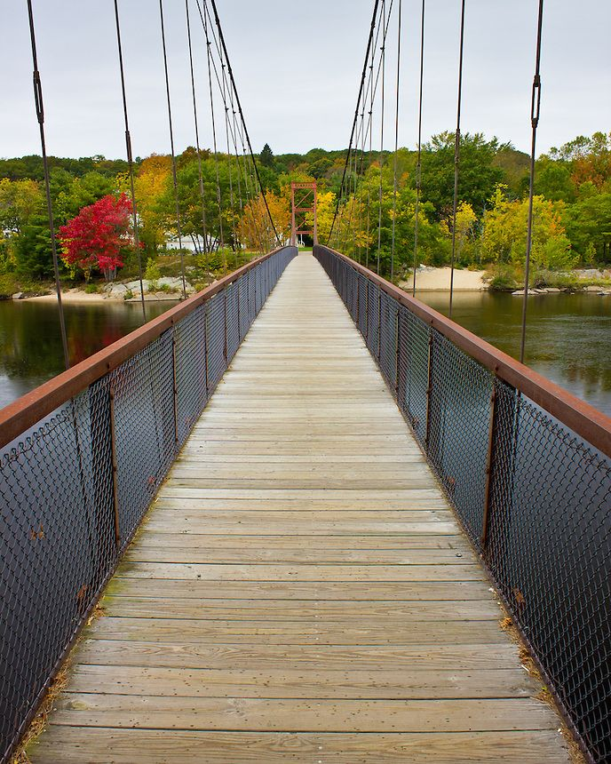 The Androscoggin Swinging Bridge. Built in 1892, this historic walking bridge connects Brunswick and Topsham Maine.