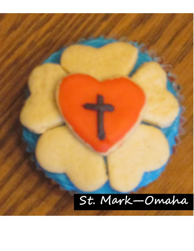 Sunday school snack - Luther's seal (Luther's rose) cupcakes for Reformation. The rose and the heart in the center are tiny heart shaped sugar cookies that the kids arrange on a blue frosted cupcake.