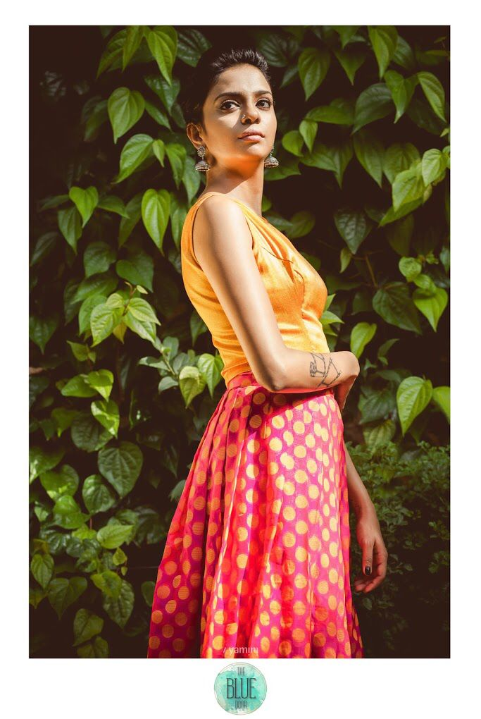 Orange and pink polka dotted crop top and skirt.
