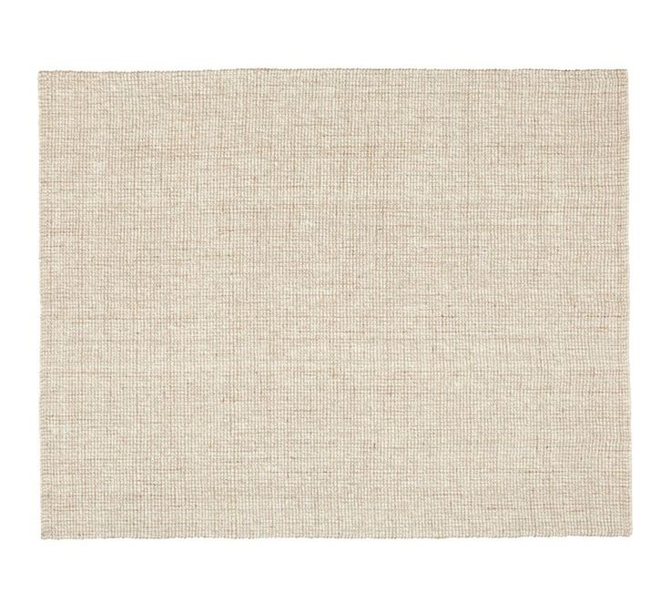 Chunky Wool & Natural Jute Rug This rug is from Pottery Barn. Also try Bayliss Rugs