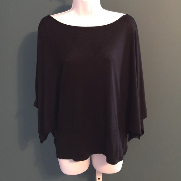 "[HP] BLACK BATWING TOP This trendy black top can be worn with your favorite jeans. Completely open arms with a banded waist. Can wear off shoulder.  Neck measurements are 13"". Wing to wing 37"" band 18"". These measurements are laying flat. Great for wearing running errands or out with the girls. ⚫️NO TRADE. NO PAYPAL⚫️HP Soprano Tops Crop Tops"