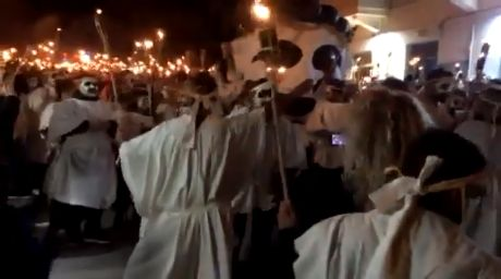 Impressive Torchlight bearers with painted faces and dressed in white sheets contribute to the unique and special style of the carnival events in Naxos.#naxos #SmallCyclades #Aegean #Cyclades #lampadifories #Apokries #Carnival_of_Naxos