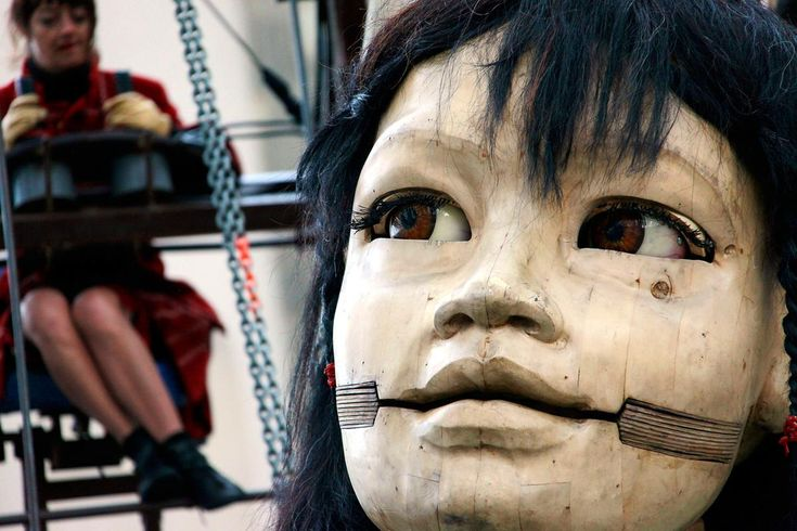 A giant marionette, operated by performers, walks in Berlin, Germany, on October 2, 2009. The French marionette street theatre company Royal de Luxe gave open air performances around the Day of German Unity in Berlin. The artists used the giant puppets to tell the story of separation and recovery to commemorate the fall of Berlin Wall 20 years earlier.