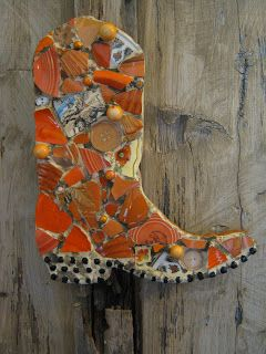 Orange mosaic cowboy boot. I like this idea for the bunk house.