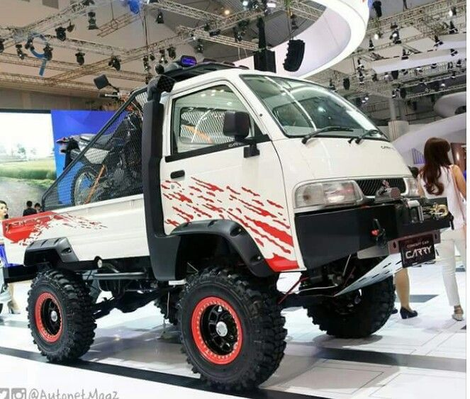 Don't know any details. But a nice lifted Suzuki Carry ...