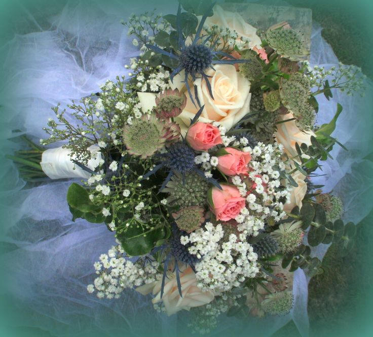 Summer time wedding bouquet with spray roses, roses, astrantia, gyp and eryngium.