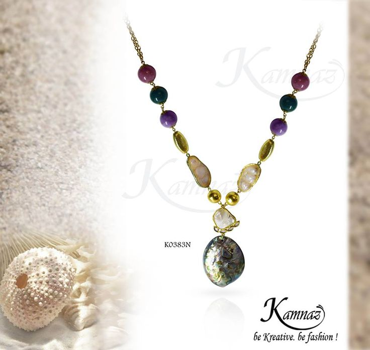 Modern yet classic...colourful yet subtle...mother of pearl neck piece with barukh pearl accents .to complete your look .