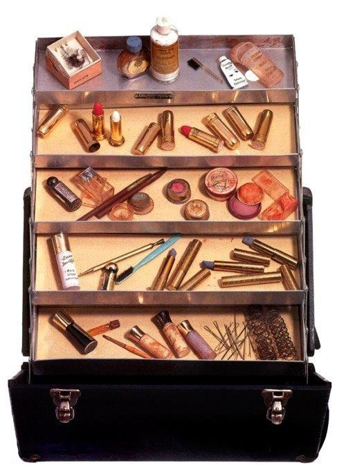 Marilyn Monroe's actual make-up case - 3 Max Factor lipsticks, 2 Elizabeth Arden cream eyeshadows (Autumn Smoke and Pearly Blue), 2 Elizabeth Arden Eye Stopper eyeliners, one brown and one black. One Leichner of London eyeshadow - Two bottles of Revlon nail polish (Cherries a la Mode and Hot Coral) - Glorene of Hollywood eyeliner and false eyelashes - Two bottles of perfumed lotion by Shisheido  - Anita d'Foged Day Dew cream makeup and cover up - Two pots of Erno Lazlo make-up.