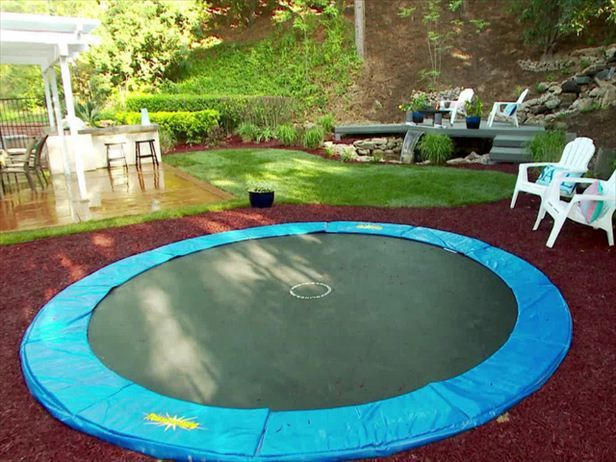 This  in-ground trampoline  is a great way for your children to expend all of their energy. A rubber mulch surround has been installed to keep it safe.