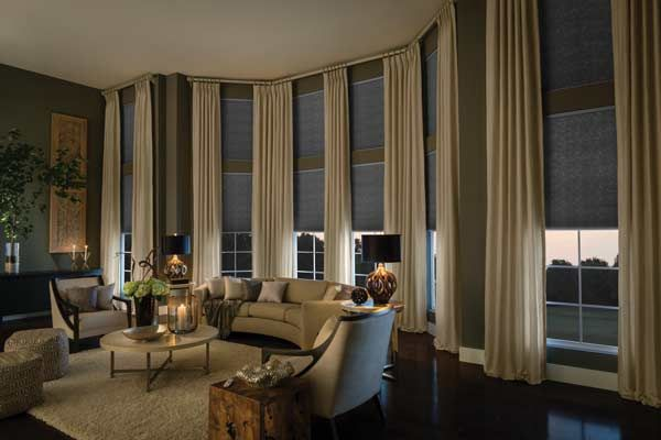 The textiles of cellular shades balance out the sheer look of the long panels.