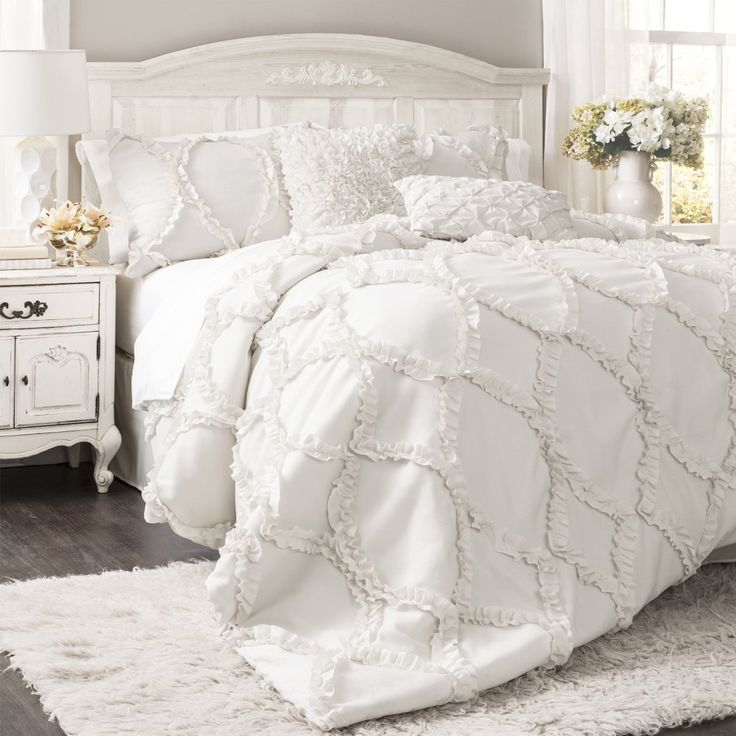 Set comes with comforter and matching pillow shams featuring ruffle ribbon embroidery. (Ruffled square euro pillows & decorative pillows in photo are not in