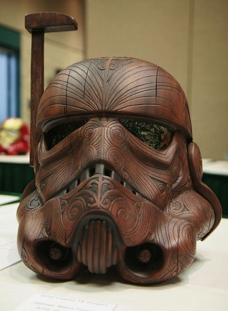 Stars Wars character mixed with a Maori inspired tattoo. An amazing effort to cross a culture with Sci – Fi, and to the artist Daniel Logan of using a Star Wars character as the center piece. Striking Maori Ta Moko covers the helmet and the inserts for the eyes are paua or commonly know as abalone. The Stormtrooper Helmet made by Daniel Logan for the 501st TK Project — a charity event for the Make A Wish Foundation to create one of a kind stormtrooper helmets.