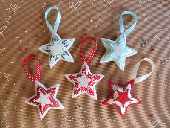 Soft stars to decorate the Christmas tree. Made with felt, ribbons and beads