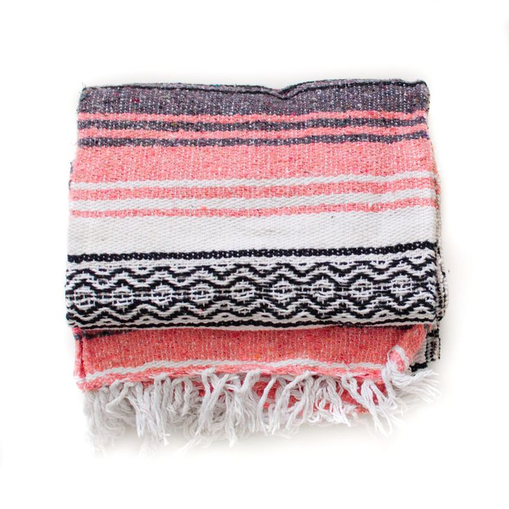 """These vibrant blankets are an essential for the traveler. They're perfect for road trips, camping, picnics, and pretty much anything else you can think of. thick and cozy. measures approx. 72"""" long an"""