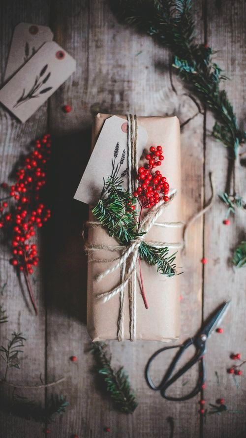 Red berries and fir gift wrap.