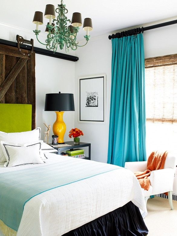 Love the spring-like grass green on the bedhead and bold turquoise on the drapes