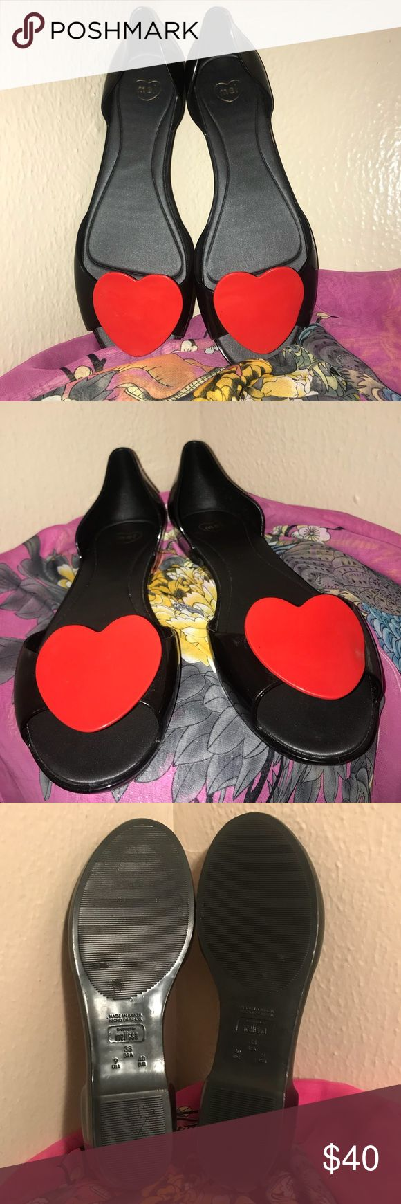 Melissa peeptoe jelly flats black and red valentine heart jelly shoes by none other than Mel dreamed by Melissa. made in Brazil, has the signature yummy bubblegum smell 🍭🍭🍭🍭 I got these but never wore them because they fit me a little big (I wear 8.5 sometimes 9) there is like one tiny scratch on the side of one shoe. u can barely see it. kawaii kicks for a real sweetheart! Mel by Melissa Shoes Flats & Loafers