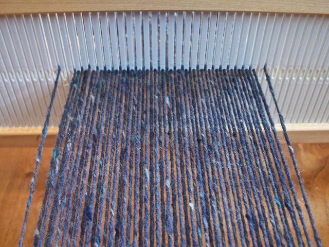 http://www.ravelry.com/projects/jeen/floating-selvedge-on-a-rigid-heddle-loom