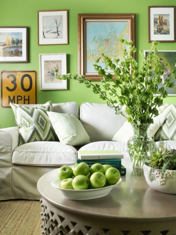 Crisp Apple Green Living Room With Neutral Sofa and Framed Art Gallery Wall