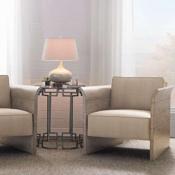 Product Name: Kennewick Chair by Caracole. Sink into rustic luxe; Ideal for those days indoors; reading, relaxing or entertaining. The gentle turn of the cluster oak planking sides create a focal point against other soft, upholstered furnishings in the family room. A comfy deep seat, sloping back and loose back-pillow make this a favorite resting spot.  Available exclusively at Space Design Collective in India. www.spacedesigncollective.com