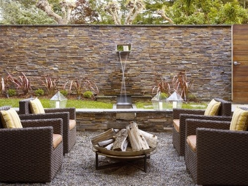 horizontal slate and a cap on top... contemporary patio by Mark English Architects, AIA