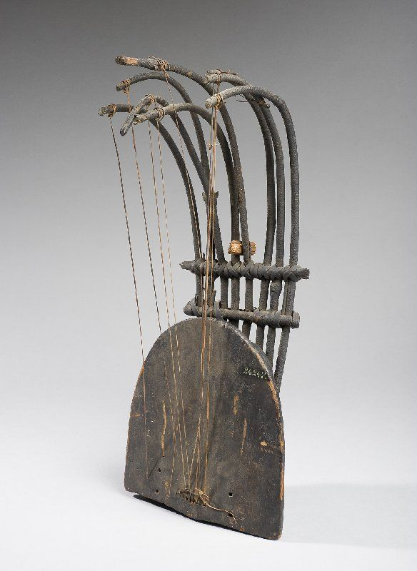 MusicArt PLURIARC. Also called Bow Lute,  west African stringed musical instrument having a deep boxlike body from which project between two and eight slender, curved arms; one string runs from the end of each arm to a string holder on the belly. The strings are plucked, usually by the fingers, occasionally by plectra attached to the fingers. They are generally played open, as on a harp; in some regions they are stopped, as on a lute. The pluriarc, possibly derived from the musical bow, is…