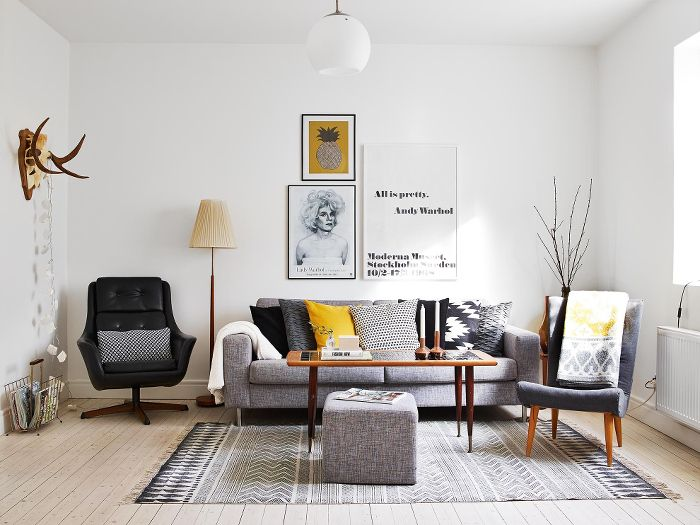 (Of course the chairs were moved for the photo ;) Great apartment in Göteborg | NordicDesign - living room, black, white, grey, yellow
