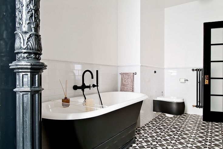 Gorski Residence by FJ Interior Design, free standing bath tub and floor tiles in a monochrome pattern