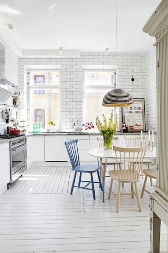 neutral kitchen with a powder blue chair