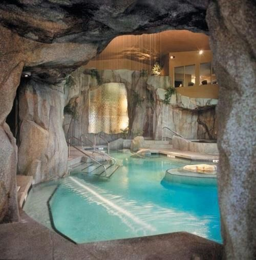 Swimming Pool In A Cave With Rainfall Waterfall