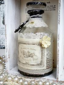soldered bottle, added a French label & a fleur de lis charm
