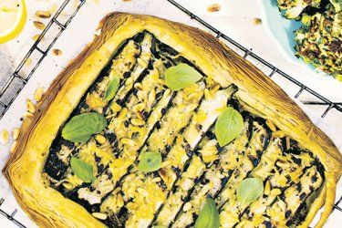 Courgette, parmesan and garlic tart with green olive dressing