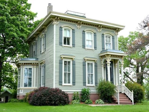 Exterior of Centerville, Iowa Home: Built in 1870, here is your chance to own a piece of Centerville heritage for just under $300,000. The property includes 23 acres of Iowa pasture and timber with six acre yard, two acre pond with three bridges and a large pond gazebo.