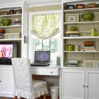 Stock cabinets trimmed with molding and beadboard behind the shelves give this workspace built-in a custom look at an affordable price. | Photo: Tria Giovan | thisoldhouse.com