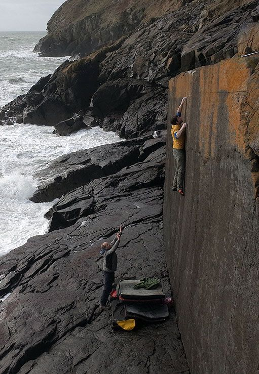 Pete Robins on the first ascent of Bytilith Wall (7C+/8A), Lleyn Peninsula, Wales.