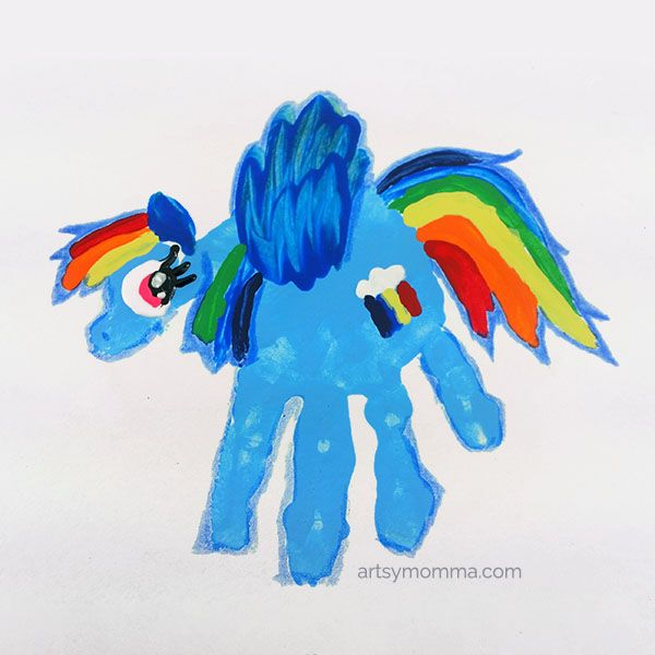 Have a nostalgic mommy & me craft time: Make a My Little Pony Rainbow Dash Handprint Craft + read My Little Pony books for storytime and play!