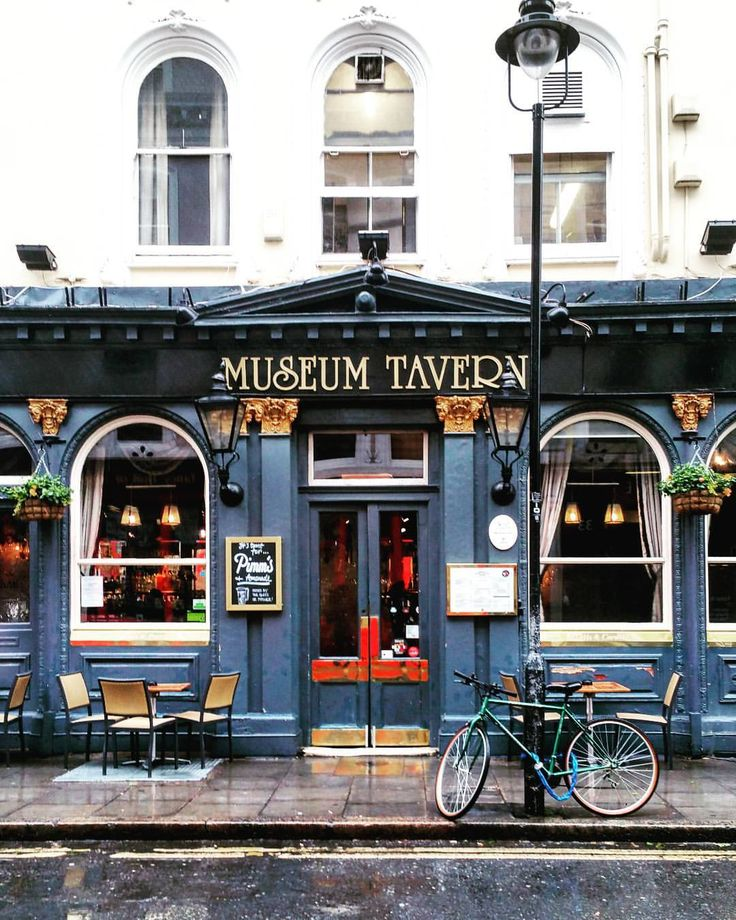 London store front - museum tavern with outdoor table, lamp, bicycle