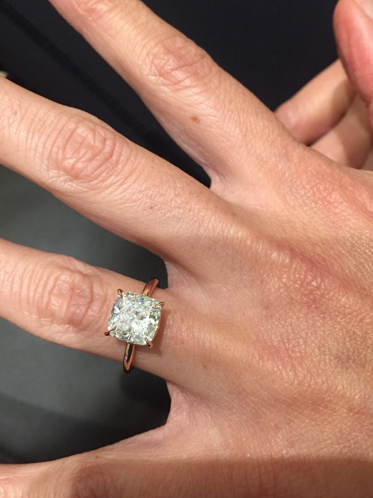 Perfection - simple, thin rose gold band and a cushion cut solitaire!