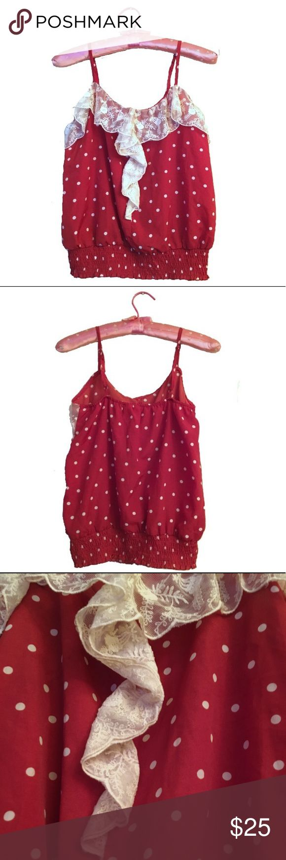 Red Camel burned orange polka lace strappy tank *Size: Medium* *100% polyester* *Machine wash cold/gentle cycle* -Burned orange exterior with white polka dots -Frilly Lace neckline in front -Adjustable spaghetti straps -Elastic cinch at hip length -Never worn +Pairs well with jeans/shorts and sneakers/heels/flats. Red Camel Tops Blouses