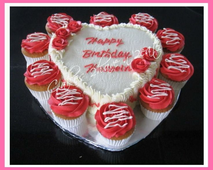 HEART SHAPED CHOCOLATE BIRTHDAY CAKE WITH MATCHING VANILLA CUPCAKES BEAUTIFULLY DECORATED IN BUTTERCREAM WITH HANDMADE ROSES