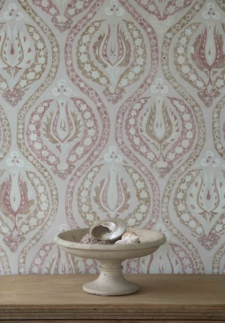 Benaki Wallcovering An eastern inspired wide width wallpaper with a subtle washed out print effect in mocha and slate blue on light beige.