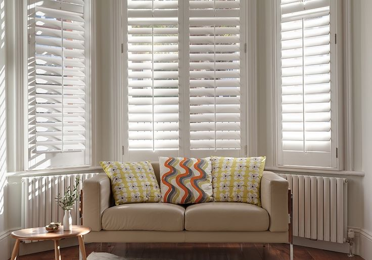 Full height bay window shutters for a lounge