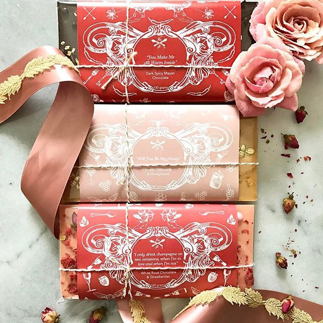 💋Art & Pastry lovers cupids arrow is striking today! We are crushing over our 2017 St. Valentine Collection.  Melting hearts with a trio of signature chocolate bars Strawberries & Champagne Rose🍓🍾 Dark Spicy Mayan 🌶 Dulcey & Honeycomb 🍯 $12 ea.  Please place all inquiries & orders to contact@nadiaandco.com  Pick up and delivery available February 10th-14th.  XO  #NadiaandCo #ArtandPastry #stvalentinesday #happyvalentinesday #vday Wrapper designs by @serenaaco