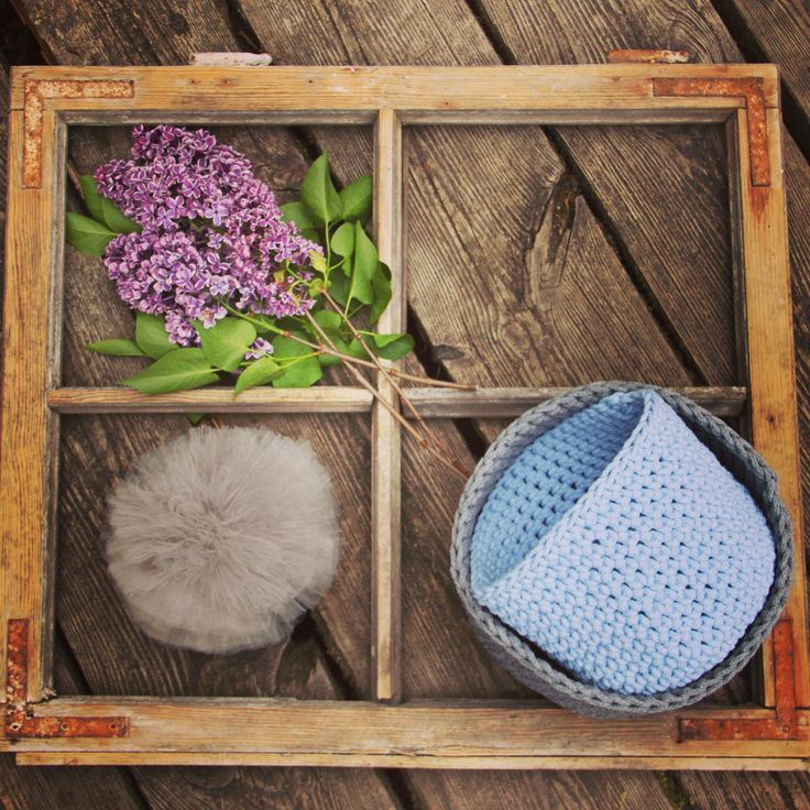 Our crochet baskets- gray and baby blue- in a vintage window. Simple chic.