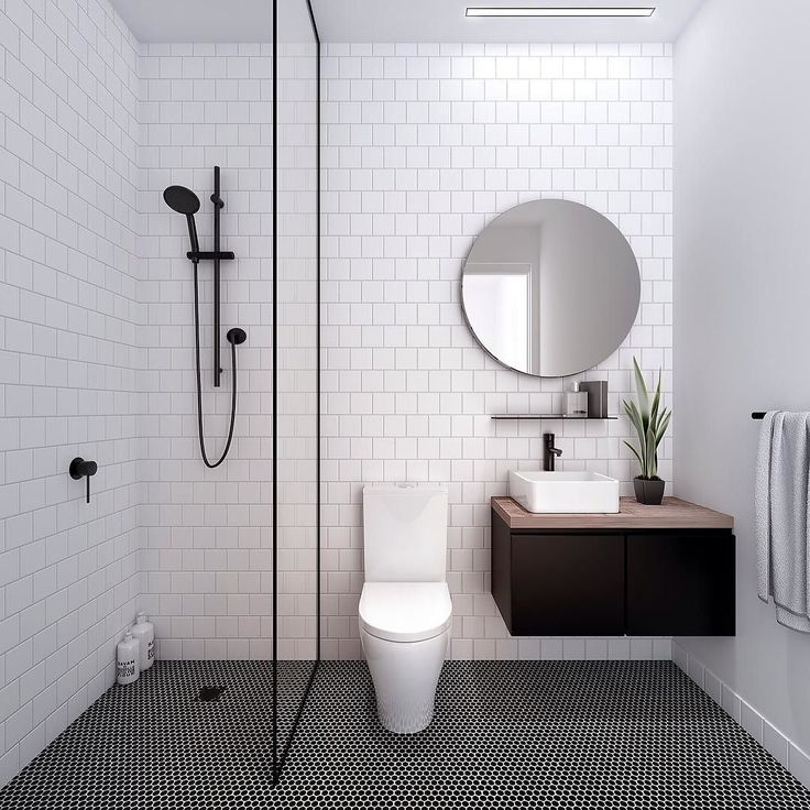 dream bathroom no bath black brassware white subway tiles to the walls black penny rounds to the floor and a round mirror id swap out the toilet