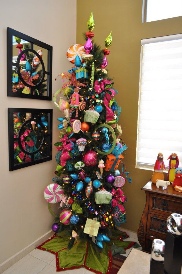 christmas tree oversized brightly colored ornaments on a slim tree - Christmas Tree Slim
